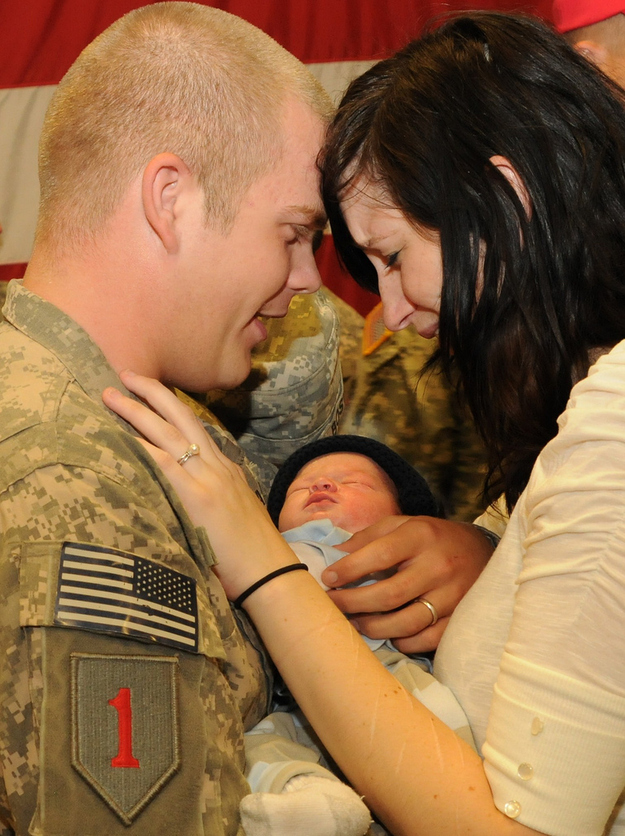 PFC Jordan Boswell meets his 9-day-old son Conner.