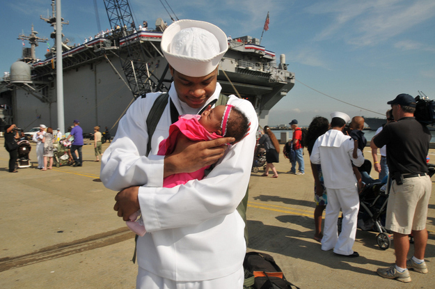 Sailor Demontay Blue meets his infant daughter