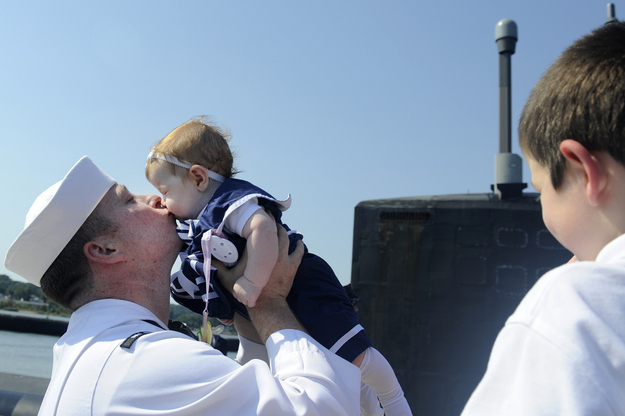 Sailor Michael Ball meets his 4-month-old daughter.