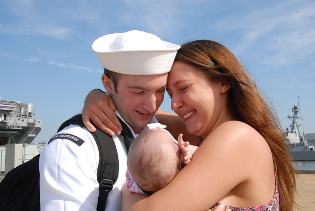 Sailor Roberto Valentine meets his infant daughter.
