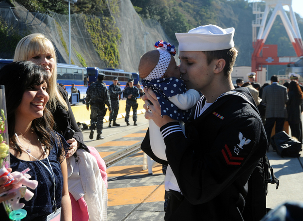 Specialist Barrett Lafferty meets his infant daughte