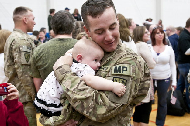Specialist Ryan Tremble meets his 9-month-old daughter, Jade