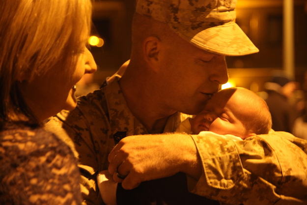 Staff Sgt. Mark Mattson meets his 3-week-old daughter, Lydia.