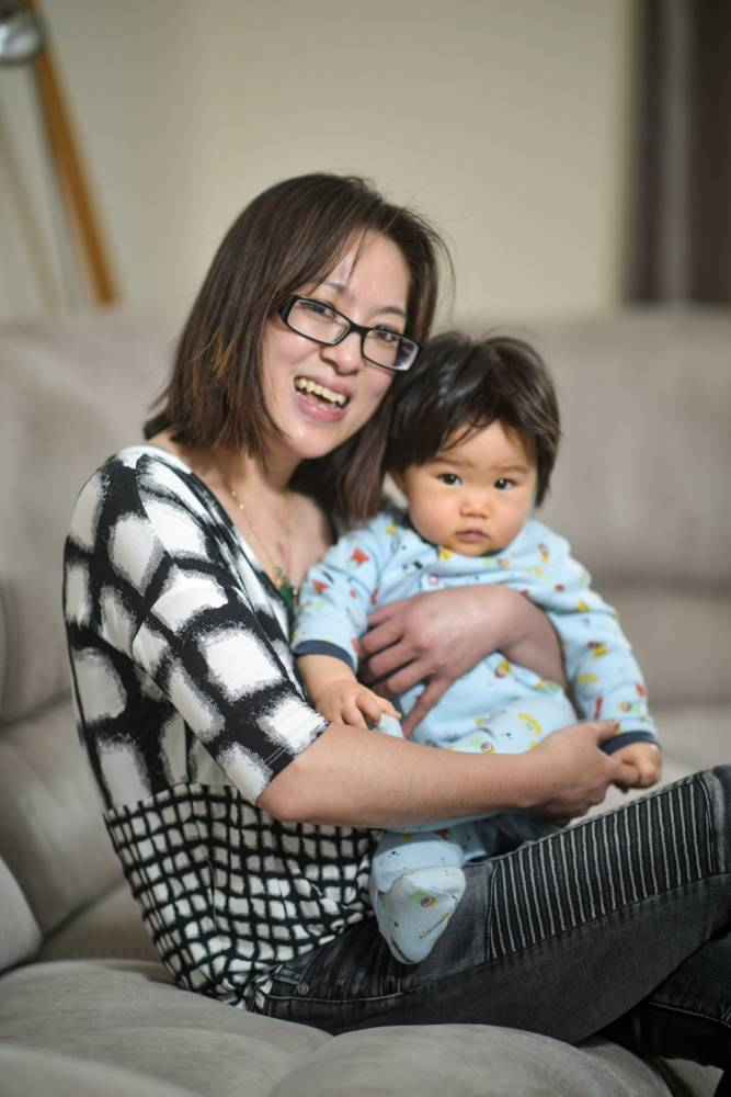 Holli Cheung, 36, is pictured with her son Jordan at their home in Aylesbury, England on May 27, 2015. A mum who suffered a major heart failure after being struck down by a rare virus was miraculously brought back to life after her sleeping BABY son was placed next to her hospital bed. See NTI story NTIMIRACLE. Holli Cheung, 36, suffered a cardiac arrest after she was struck down by myocarditis on January 2 this year. She was taken to two hospitals before being transferred to the Queen Elizabeth Hospital in Birmingham where she underwent two operations. The mum-of-one was then left on a life support machine for 10 days as cardiologists considered giving her a heart transplant as she lay uncommunicative in her hospital bed staring into space. But incredibly, after doctors let her husband Jason, 40, take their three-month-old son Jordan to see his mum in her hospital room, she made a miracle recovery. After leaving the tot sleeping next to his desperately ill mum for two hours her heart started beating by itself. Doctors were stunned by her rapid improvement when they arrived to do their rounds the following morning and were at a loss to explain her recovery. Yesterday (Wed), Holli, who lives with husband Jason and baby Jordan in Aylesbury, Bucks., said she is certain her son's presence mended her broken heart.