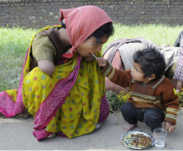 2-Year-Old-Offering-Food-To-Her-Handicapped-Mom