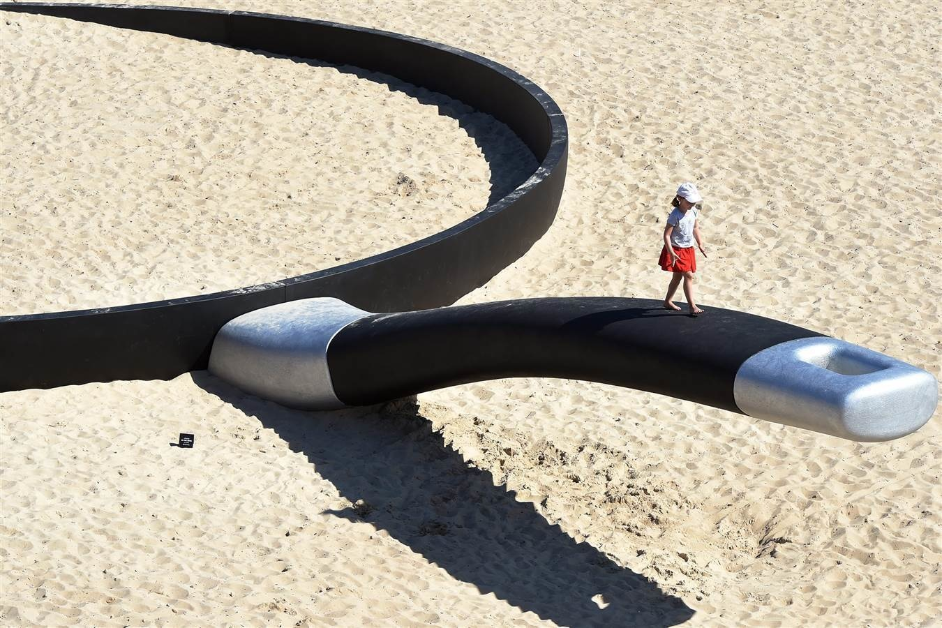 A Frying pan beach sculpture in Sydney, Australia