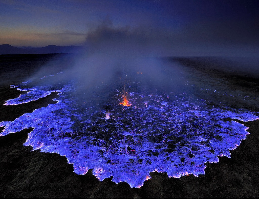 Neon blue lava pours from Indonesia's Kawah Ijen Volcano