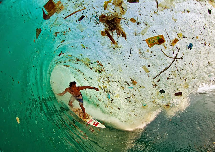 You-Will-Want-To-Recycle-Everything-After-Seeing-These-Photos-Surfing-A-Wave-Full-Of-Trash-Java-Indonesia-–-The-World's-Most-Populated-Island