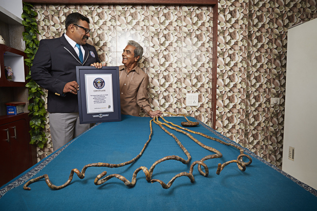 Shridhar Chillal ñ Longest Fingernails - Single Hand Guinness World Records 2015 Photo Credit: Ranald Mackechnie/Guinnes World Records Also Pictured: Nikhil Shukla - GWR Adjudicator