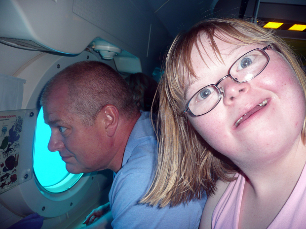Photo credit: PA Real Life. Pictured: John  with Vicky in a Submarine, 2009 Barbados.   Usage: ANY publication (print, online, broadcast) of this image will incur a fee. Contact PA Real Life Online Editor Anna Roberts on +44 (0) 2079637218. Story: John Silk, a Porsche-driving businessman told of how he traded in his career-driven life so he could afford to show his Down's Syndrome daughter the world and see her everyday.  Former employment agency owner John Silk, 55, swapped his high-flying job for odd jobs, sold his car and began obsessively using supermarket coupons in a bid to raise the funds needed to fulfil his daughter Vicky Silk's dream of travelling and says he has never been happier. His wife, Gerry has also changed her high powered personnel job to spend time with VIcky.