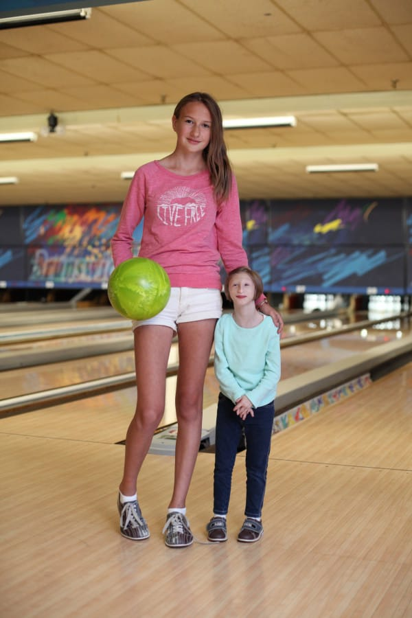 Image #: 40560841 *** EXCLUSIVE - VIDEO AVAILABLE *** KITCHENER, ONTARIO - OCTOBER 2015: 12-year-old Kenadie Jourdin-Bromley poses with her 12-year-old friend at a bowling alley in Kitchener, Ontario. AT TWELVE years old tiny Kenadie Jourdin-Bromley stands at just 39.5 inches tall and weighs the same as a two year old. The bubbly schoolgirl has defied doctors since the day she was born weighing just 2.5lbs and 11 inches from head to toe. Kenadie's mum, Brianne Jourdin, 36, was told her daughter wouldn't survive more than a few days. However, despite having learning difficulties and fragile, thin bones - Kenadie plays hockey, swims, and functions in school. Ruaridh Connellan/Barcroft Media /Landov
