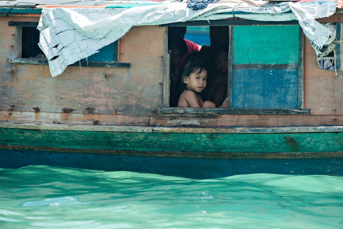 the-bajau-traditionally-live-in-small-boats-spending-their-days-drifting-in-the-ocean-and-relying-on-fishing-to-make-a-living-hence-their-nickname-sea-gypsies