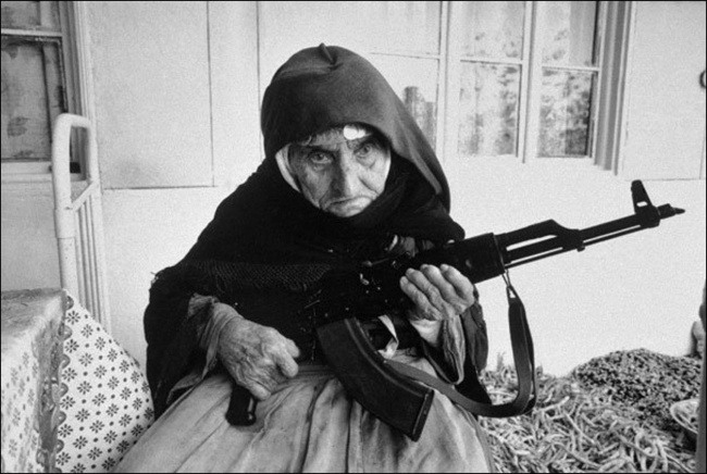 A one-hundred-and-six-year-old Armenian woman defends her house, 1990.