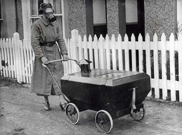 1938: An English woman pushes a special gas-resistant baby carriage through the streets.