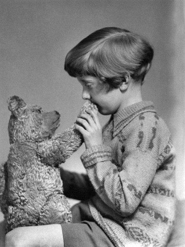 Circa 1927: The real-life Christopher Robin and Winnie the Pooh pose for a picture that's nothing short of a fairytale.