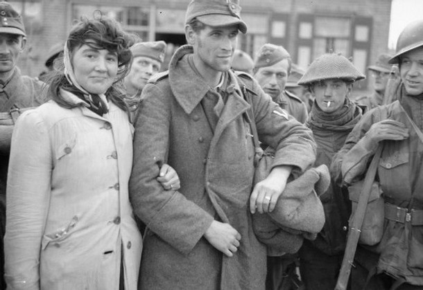 Dutch woman refuses to leave her husband, a German soldier, after Allied soldiers capture him. She followed him into captivity. [1944]