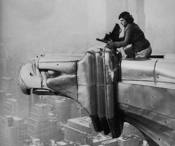 Margaret Bourke-White, a photographer, climbing the Chrysler Building. [1934]