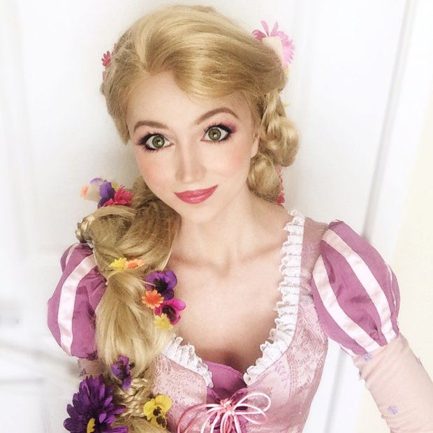 Pic by HotSpot Media - WOMAN SPENDS £10K TRANSFORMING INTO DISNEY PRINCESSES - IN PIC - Sarah Ingle, 25, dressed as Rapunzel. - Meet the real life princess who has spent £10k transforming herself into nine Disney beauties. With her petite figure and huge doe eyes, 25 year-old American beauty Sarah Ingle bears a striking resemblance to animated characters including Queen Elsa from Frozen, Ariel from The Little Mermaid and Snow White. The full time marketing manager from Denver, Colorado, spends her weekends transforming herself into fairytale princesses - entertaining children with her alter ego And being a real life princess comes with an eye-watering price tag. To date, the pretty brunette has spent £10,000 on her magical collection of 17 custom made princess outfits. Sarah, who spends up to £1500 on each outfit, says: ⿿I have always loved singing and I have always loved Disney, so it was no surprise to my family and friends when I began performing as a princess...SEE HOTSPOT MEDIA COPY 0121 551 1004