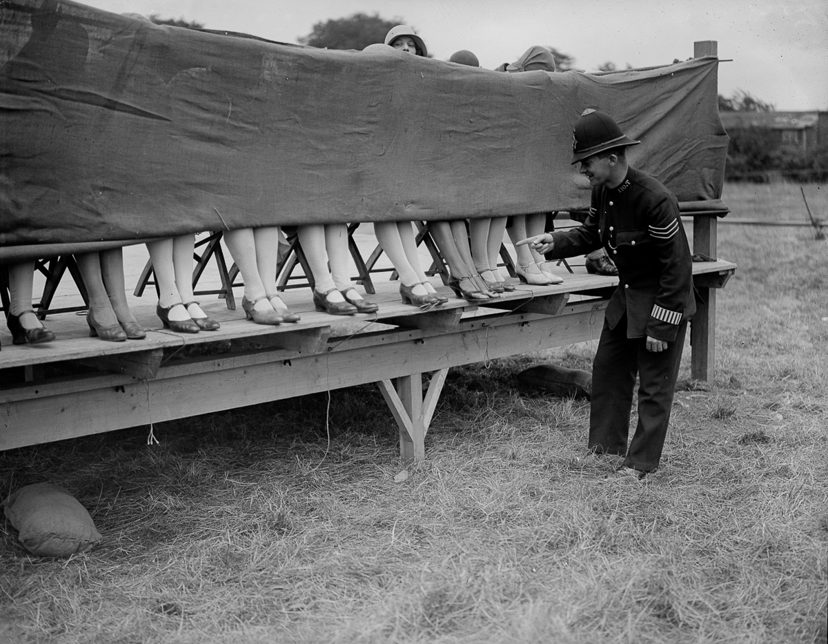 10th July 1930: A policeman judges an ankle competition at Hounslow, London. (Photo by Fox Photos/Getty Images)