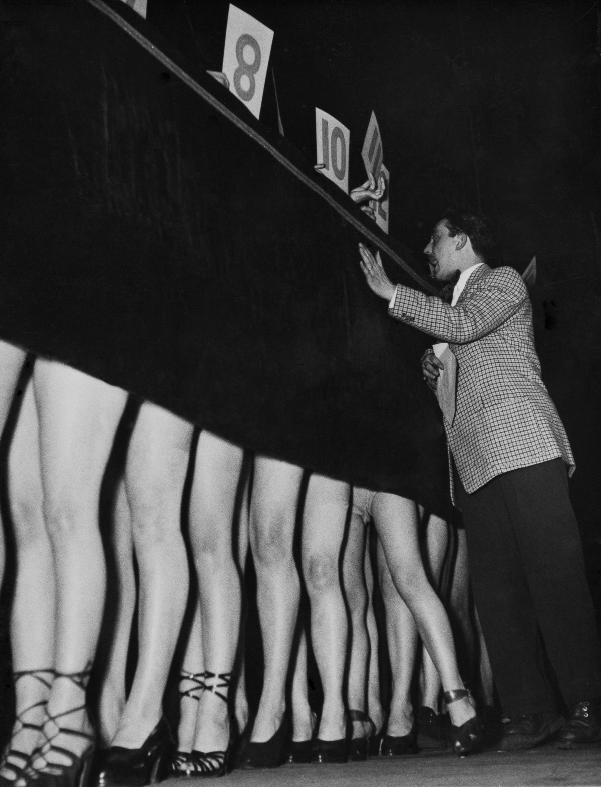 Max Japy Presenting Most Beautiful Legs Of Paris Contest In Paris On January 1950