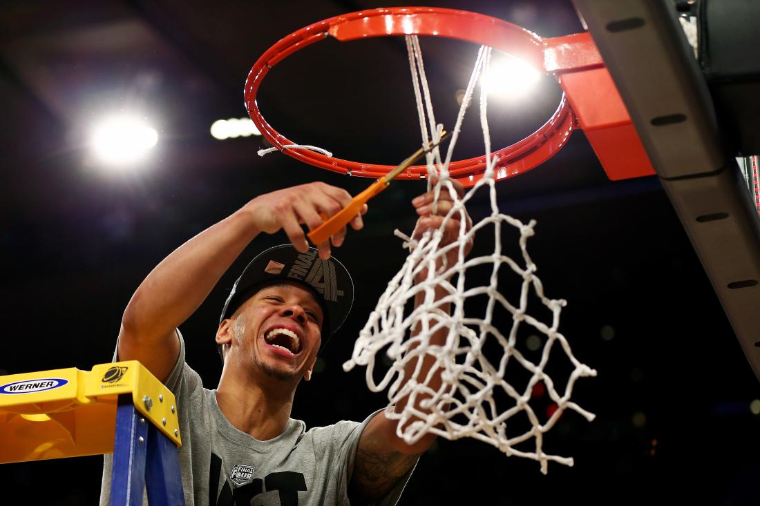 Shabazz Napier #13 of the Connecticut Huskies cuts down the net after defeating the Michigan State Spartans to win the East Regional Final of the 2014 NCAA Men's Basketball Tournament at Madison Square Garden on March 30, 2014 in New York City.