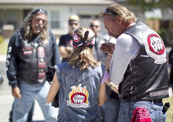 bikers 11160424kb Rembrandt, of the Bikers Against Child Abuse, talks with a new member. The group gives children in foster care the protection of a bunch of really big people wearing leather and riding motorcycles. Anonymity is part of their protection so they give the kids their very own biker name. Pat Shannahan/The Arizona Republic