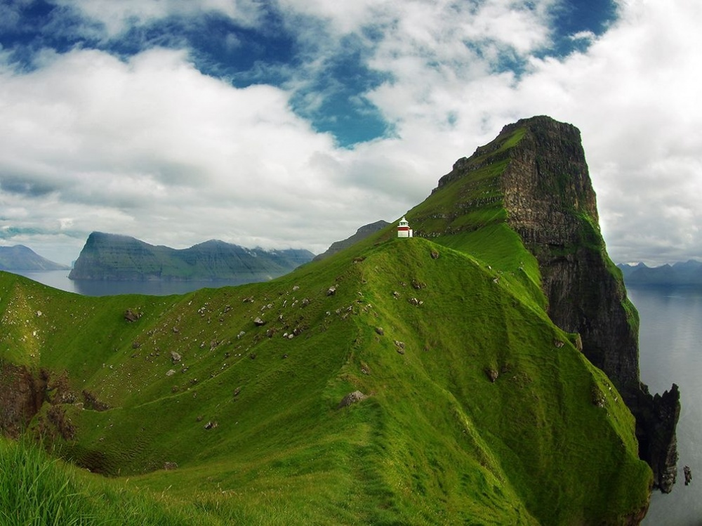 Kallur lighthouse on picturesque cliffs on Kalsoy island, Faroe Islands