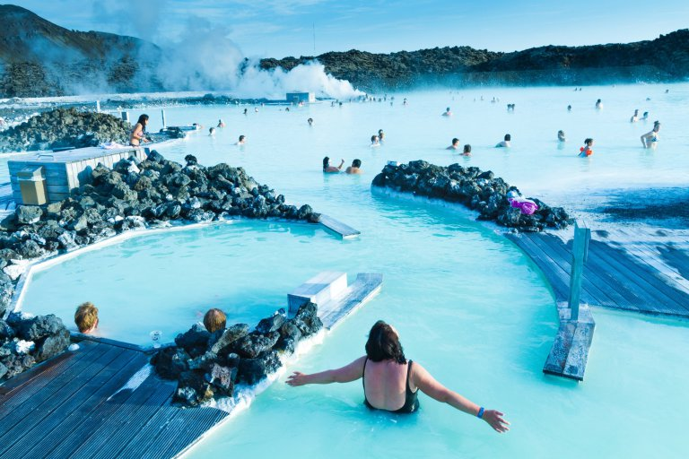 People enjoying their time in the legendary Blue Lagoon outside of Reykjavik in Iceland.