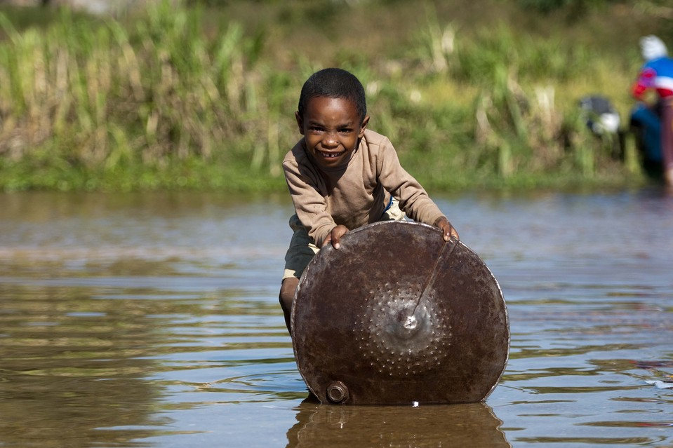 A child looked for sapphires in a river in Ilakaka town, Madagascar