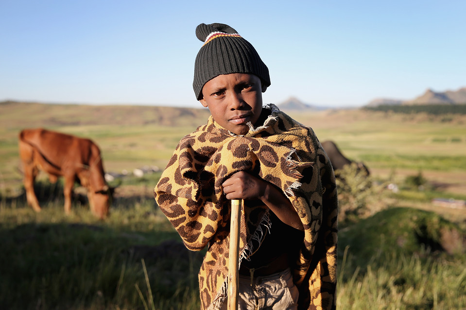 A young boy tended animals in Morija, Lesotho