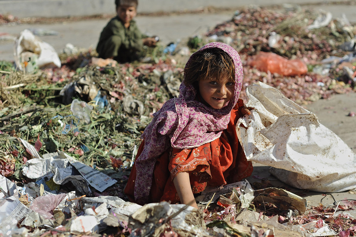 A young girl collects food from a rubbish dump in Islamabad, Pakistan