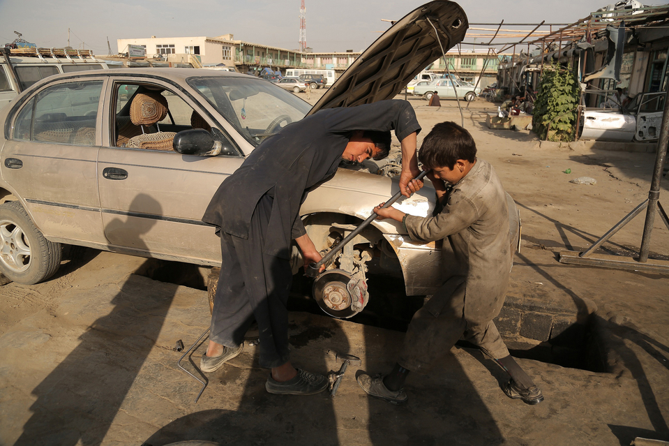 Afghan child labourers work at a mechanic shop in Ghazni on June 2, 2013. Tens of thousands of children in Afghanistan, driven by poverty, work on the streets of the war-torn country's cities and often fall prey to Taliban bombings and other violence, as well as abuse. AFP PHOTO/ Rahmatullah ALIZADARAHMATULLAH ALIZADA/AFP/Getty Images