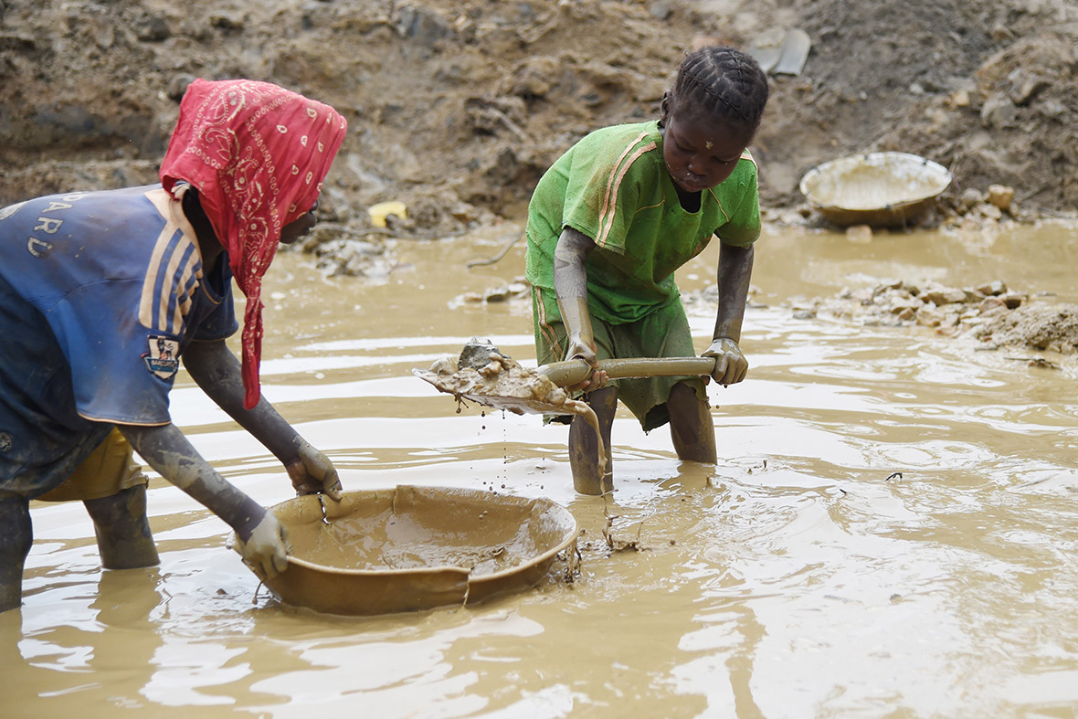 Children scour the mud for gold at the Gam mine in the Central African Republic
