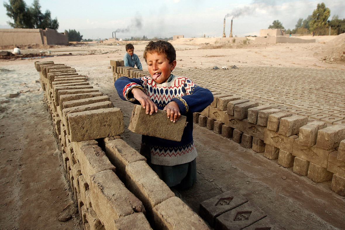 Hazrat, aged 7, works at a brick-making factory in Jalalabad, Afghanistan
