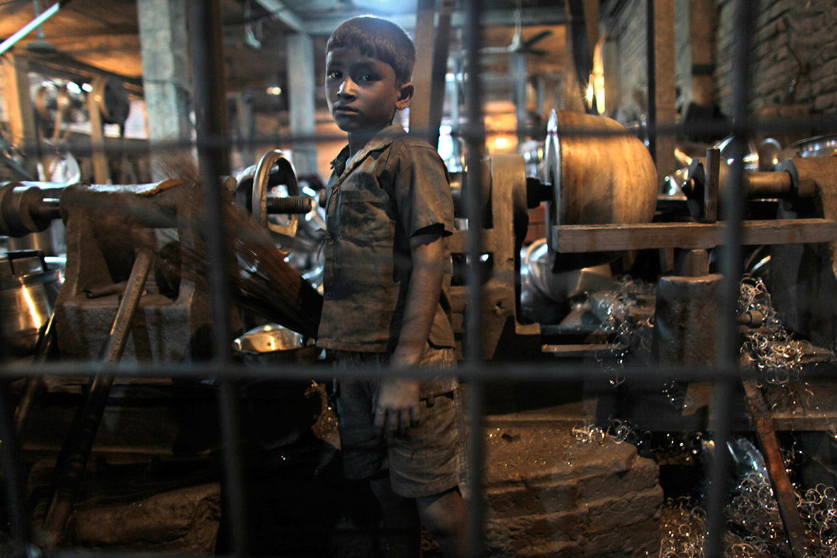 Rustam,10, works at an aluminium factory in Dhaka, Bangladesh, where about 25 children were employed, many of them working for 12 hours a day