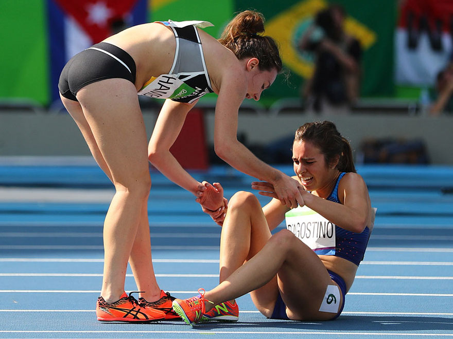 rio-nikki-hamblin-of-new-zealand-stops-running-during-the-race-to-help-fellow-competitor-abbey-dagostino