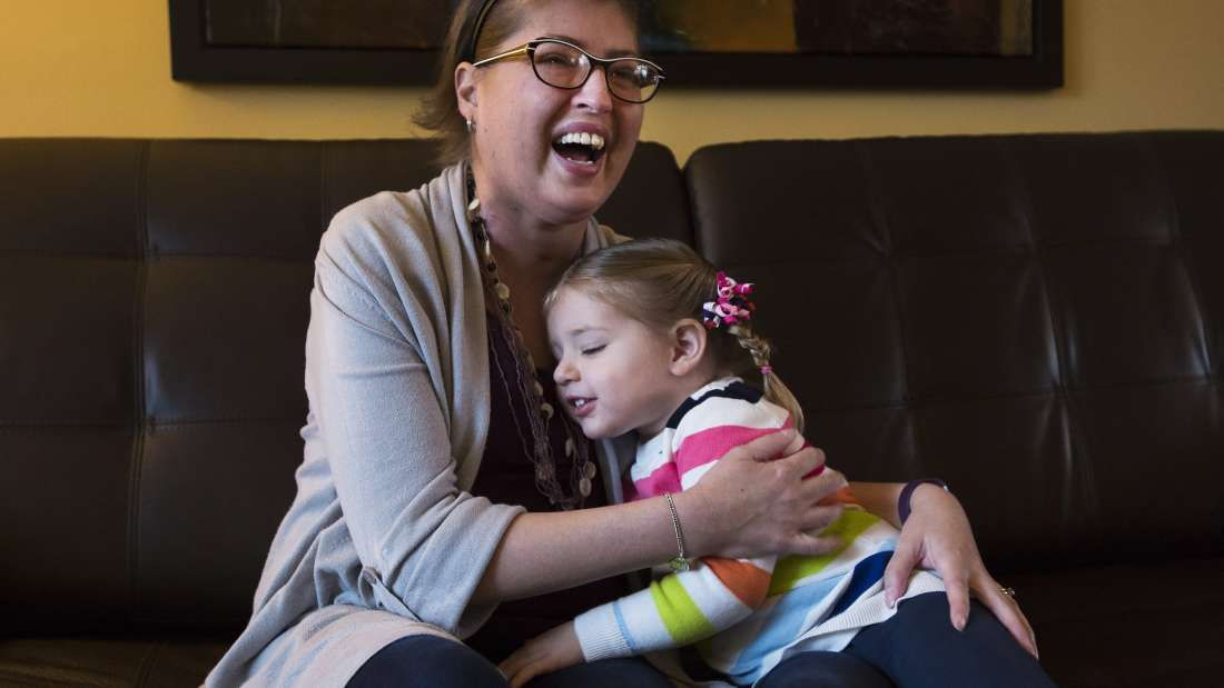 Melissa Benoit, left, who has cystic fibrosis and her daughter Olivia pose for a photograph at her home in Burlington, Ont., on Friday, January 20, 2017. Benoit was dying from a severe lung infection that had spread into her blood and put her into organ failure.To save her life, and in what they believe is a world first, Toronto General Hospital doctors removed her lungs, then put her on heart and lung machines for six days in the ICU until donor lungs became available, at which point she had a double-lung transplant. THE CANADIAN PRESS/Nathan Denette